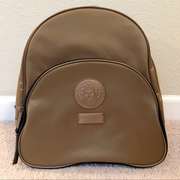 9acca015031 Versace | Versace Parfums Gold Backpack. M_5b72424df303693e7d8455b6